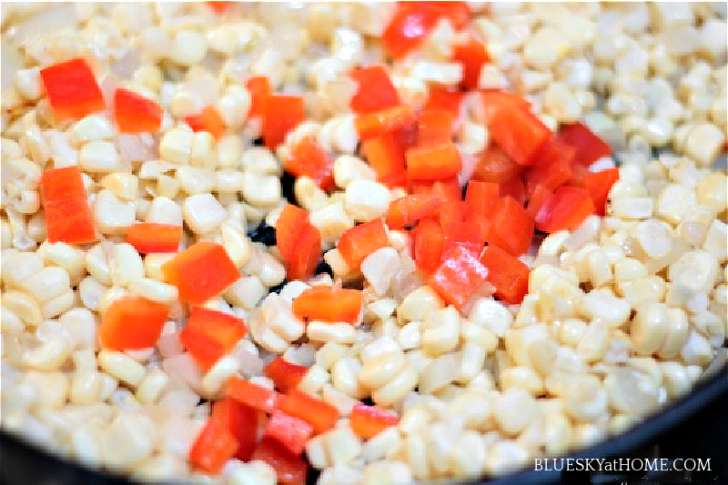 corn and diced tomoates in skillet for creamed corn