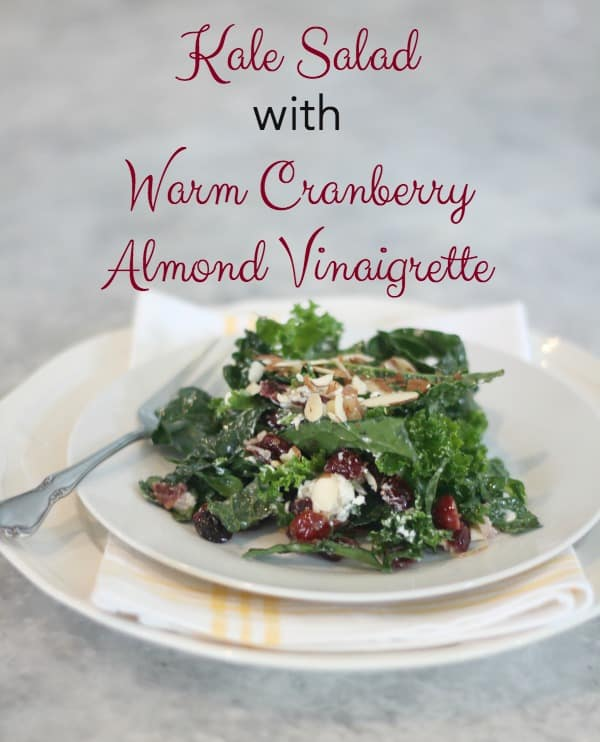 Kale Salad with Warm Cranberry Almond Vinaigrette is a perfect choice for a fireside dinner, a chilly Sunday afternoon or a fall first~course celebration.