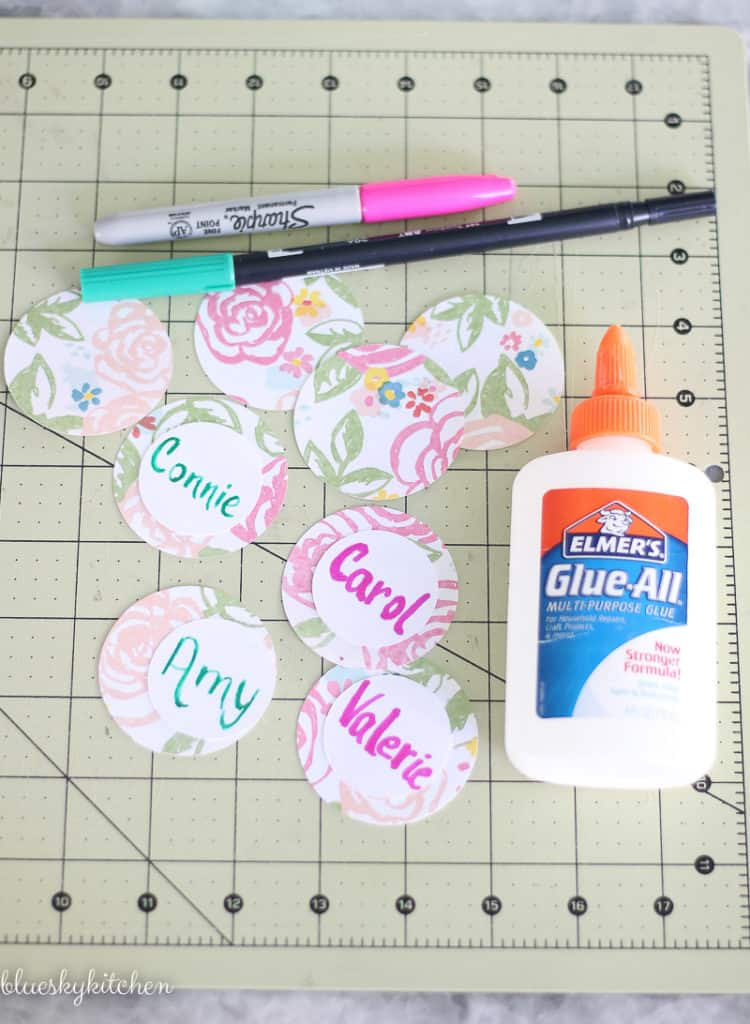 glue and round paper name cards
