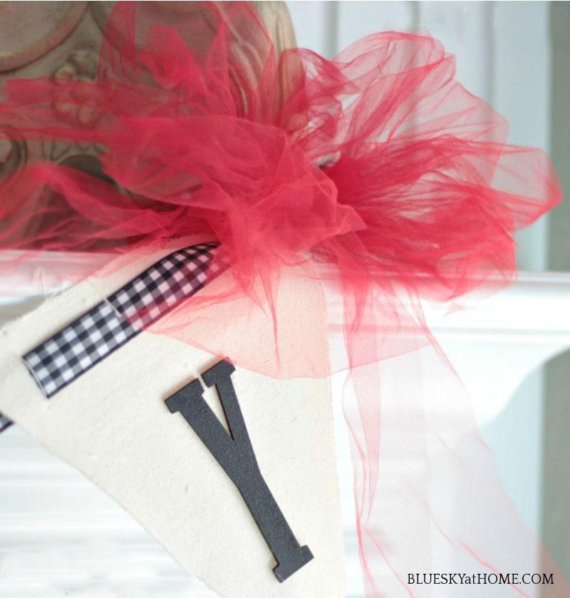 letter Y with red ribbon