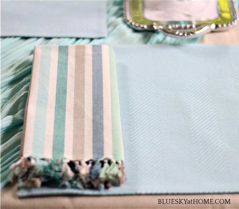 blue place mat and stripe napkin