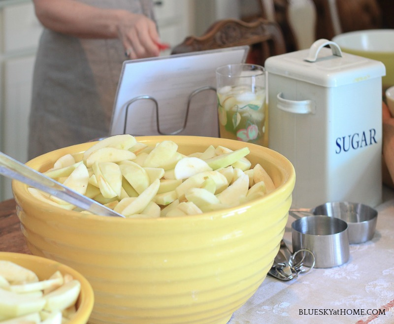yellow bowl of sliced apples