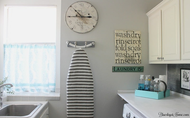 How to Make a Laundry Room Prettier and More Practical. Visit the big reveal of this laundry room makeover. Now it's pretty, practical and perfect. BlueskyatHome.com