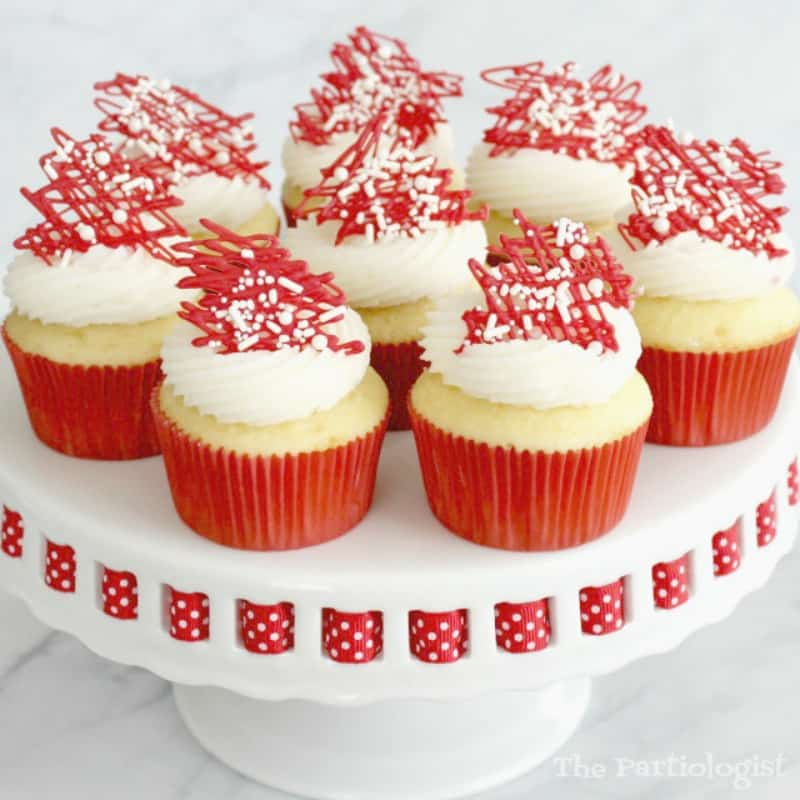 Valentine cupcakes with white icing and red sprinkles