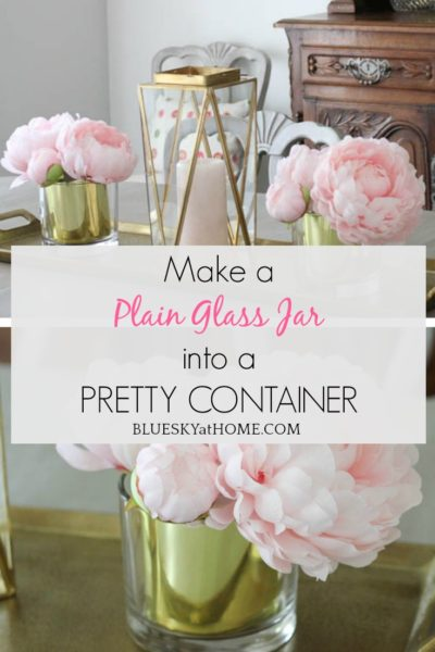 gold glass container with pink flowers