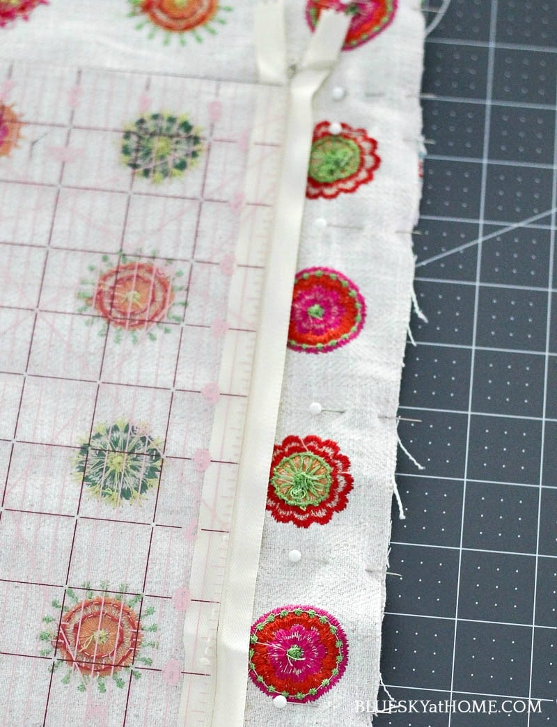 pink, green, orange embroidery circles on cream background