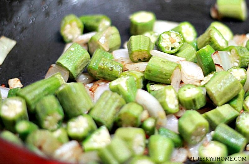 okra and onions in skillet