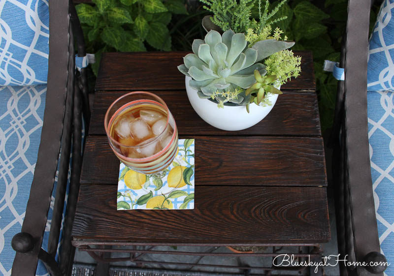 table with plant and glass of iced tea