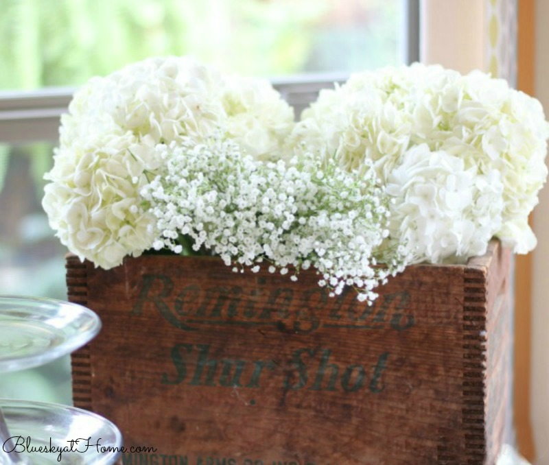 hydrangeas in box on buffet table for casual fall party