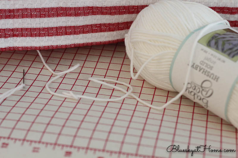 white yarn to make no-sew pillow with dishtowels