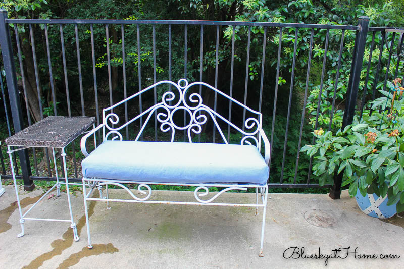 white bench with blue cushion