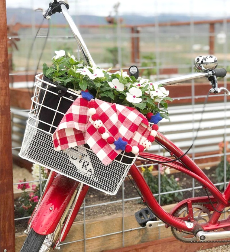 Memorial day decorations with red bicycle with red check napkin