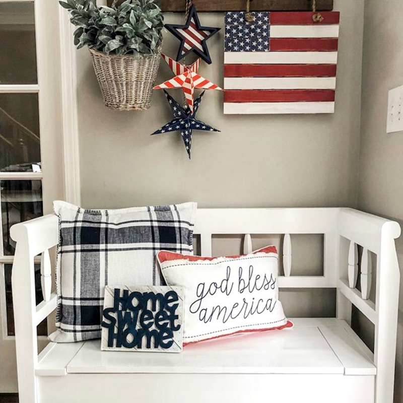 Memorial Day bench with American flag and patriotic pillow