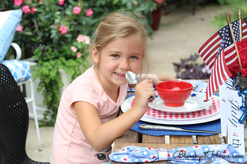 child sitting at patio table with new chairs from Wayfair
