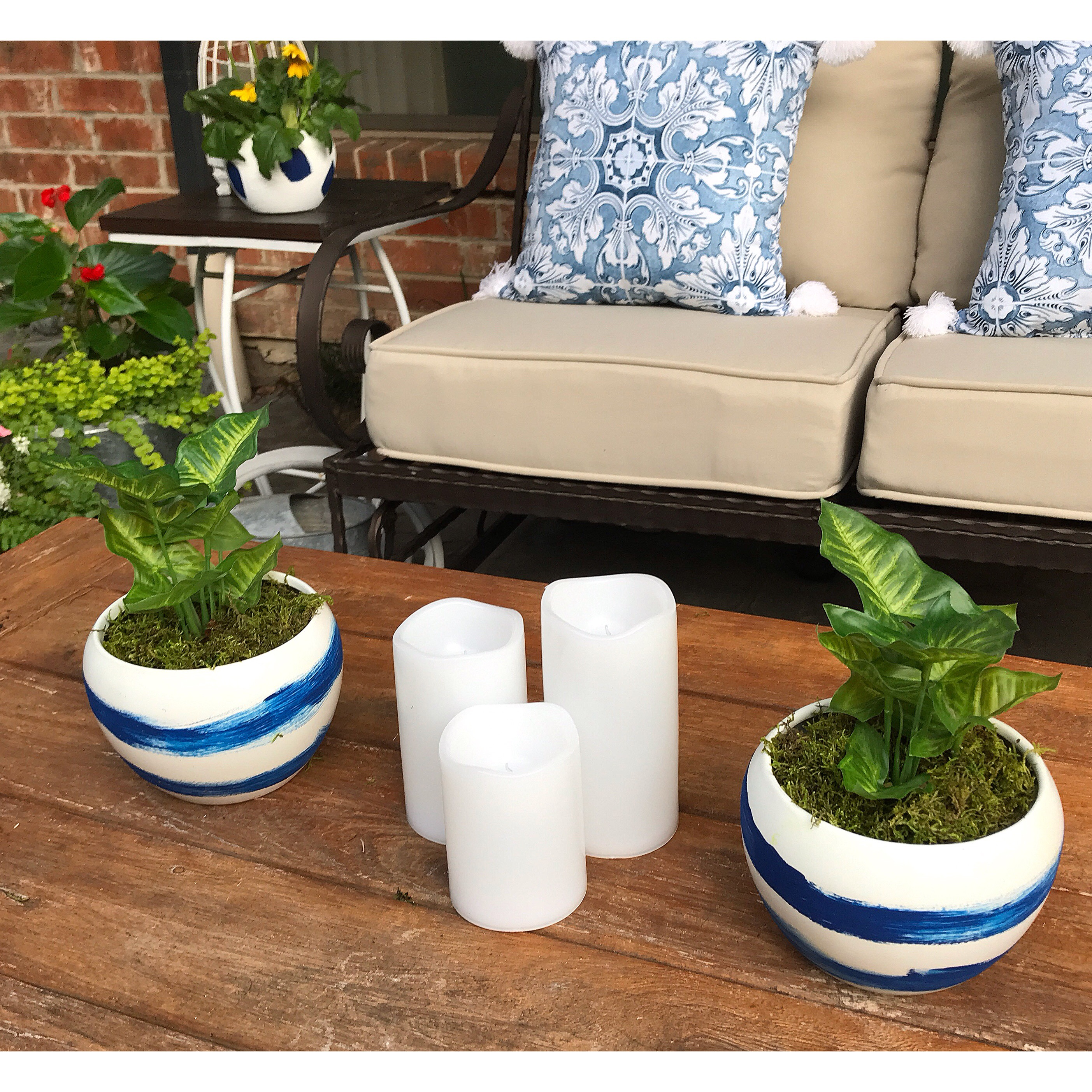 Candles and blue and white pots