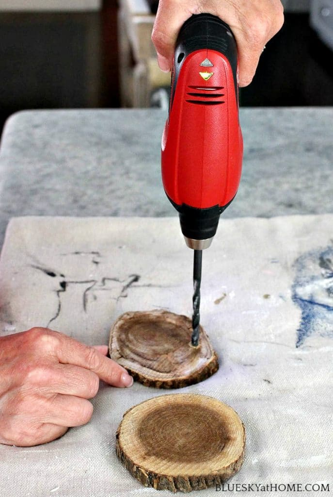 drilling hole in round wood discs for barbecue DIY project