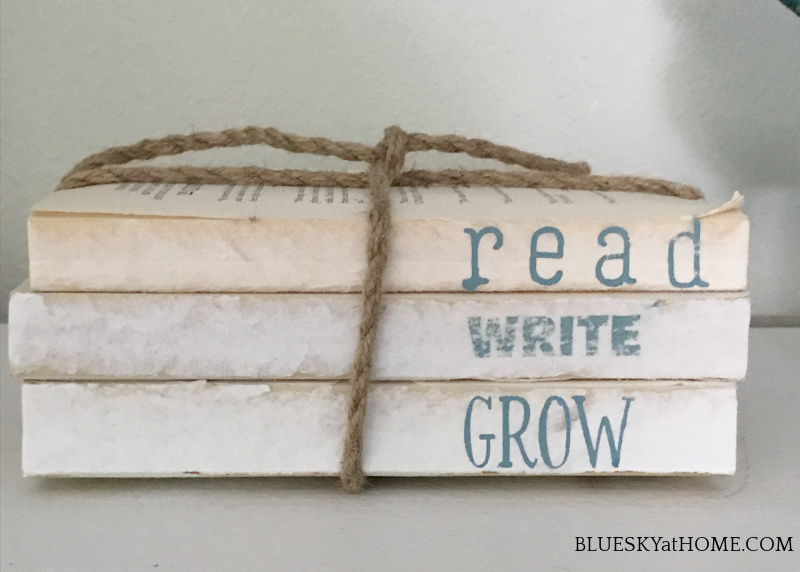 stencil on books tied with twine
