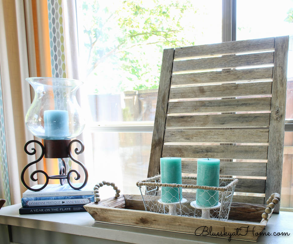 teal candles in wire basket