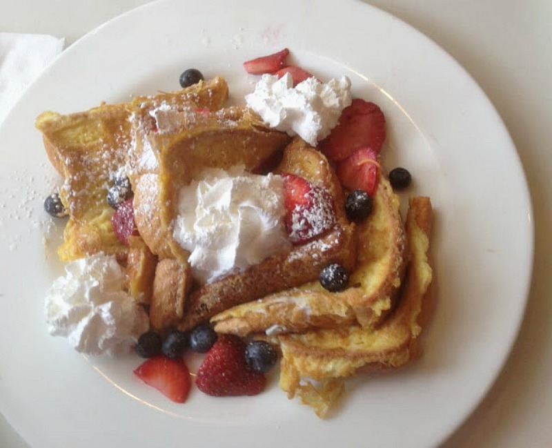 french toast with strawberries and whipped cream