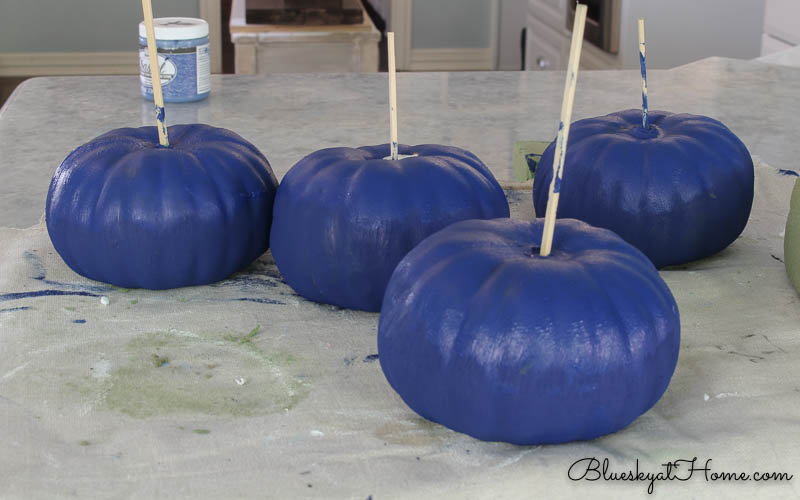 blue painted pumpkins with copper stems