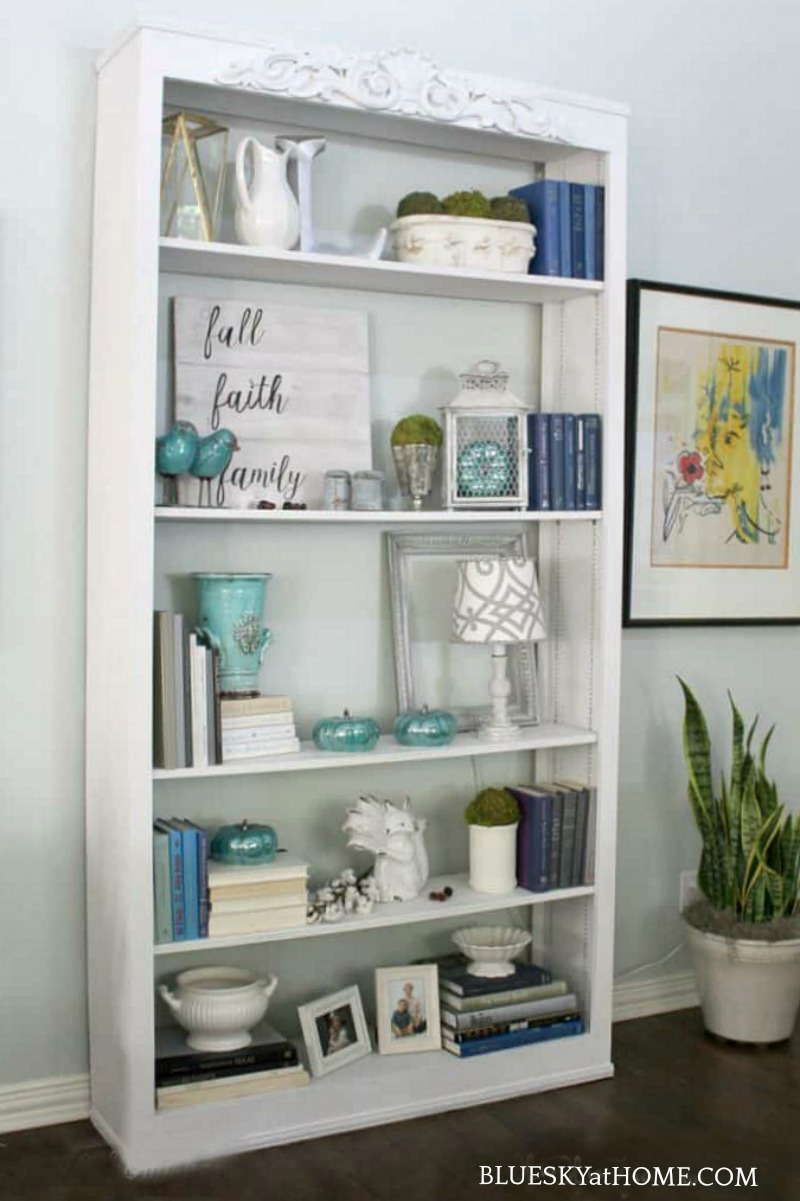 bookcase decorated with vintage fall decor