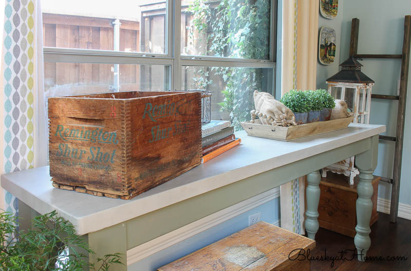 wood box on table with books