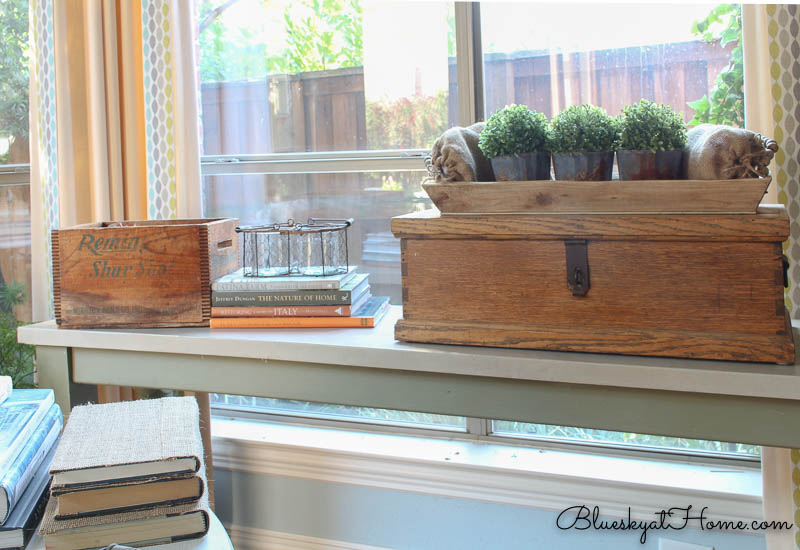 green boxwood balls on galvanized containers on wood tray