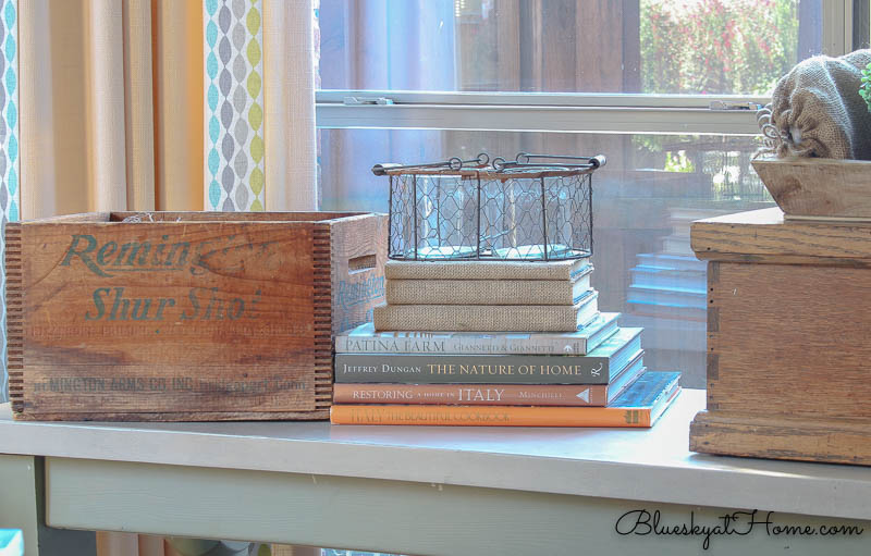 restyled table with wire and glass container on books