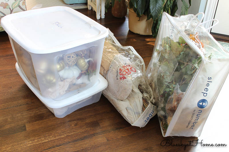 boxes and bags of fall decoraitons