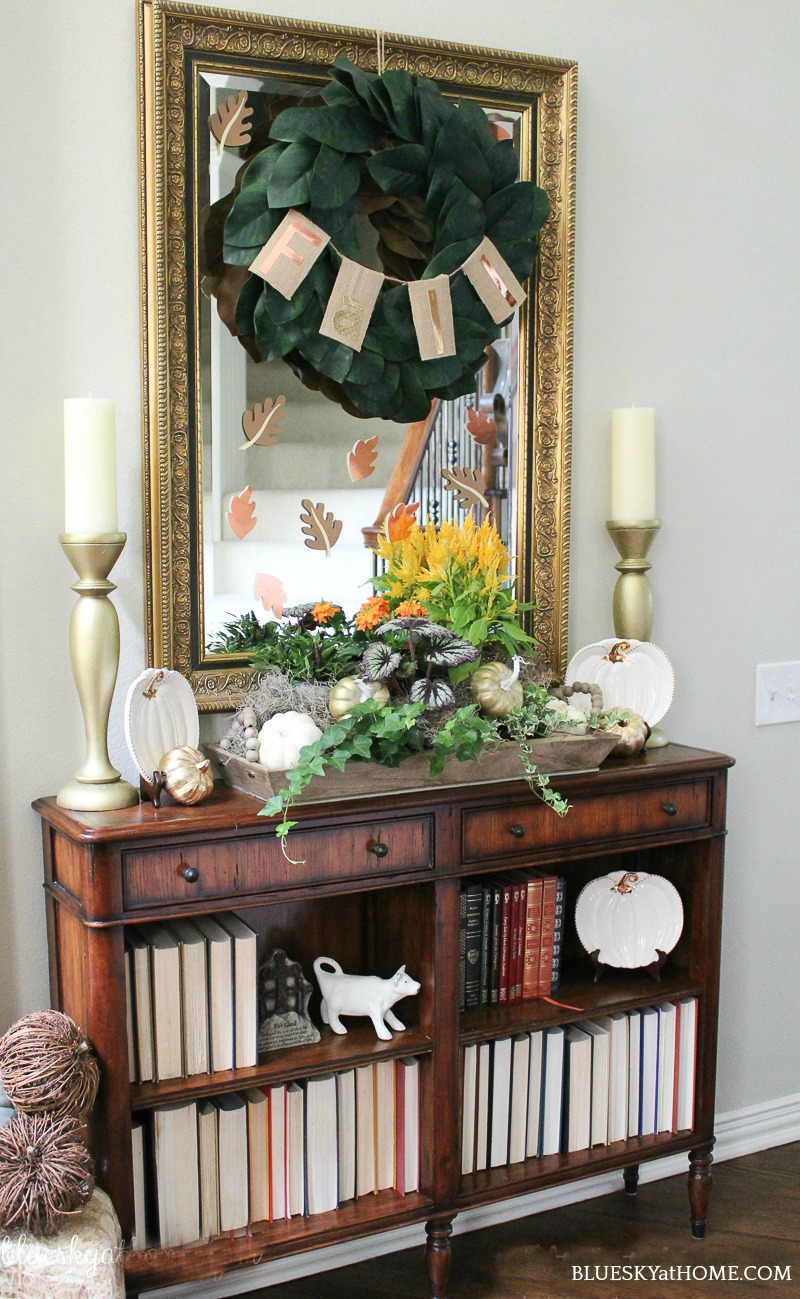 entry console decorated with vintage fall decor