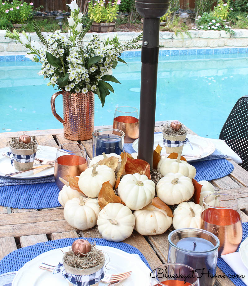 fall patio tablescape with pool in background