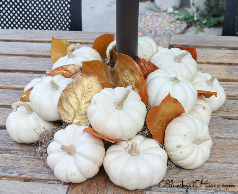 fall patio tablescape white pumpkins with gold leaves