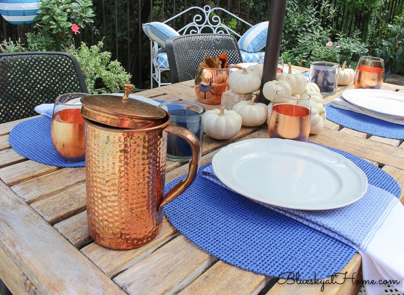 fall patio tablescape copper pitcher