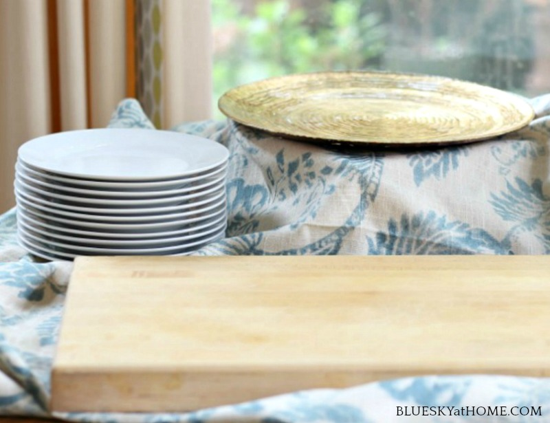white plates and wood cutting board