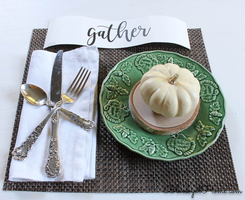 fall place setting with gather sign and pumpkin on green plate