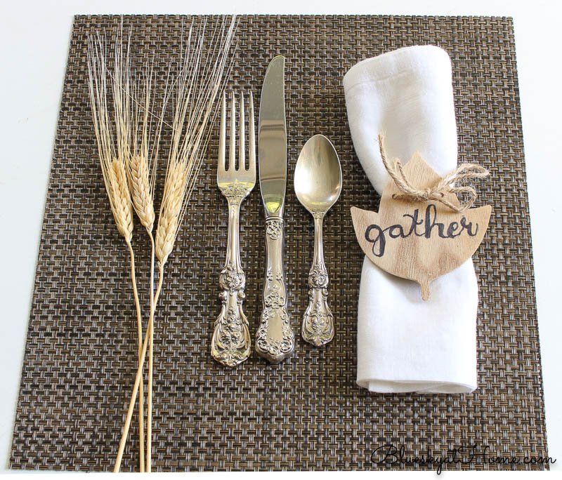 fall place setting with gather napkin ring and wheat