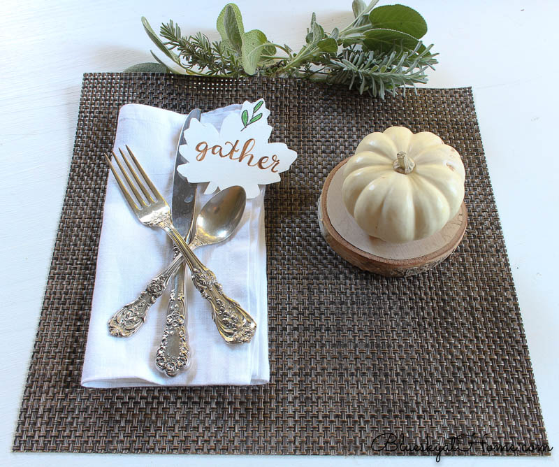 fall place setting with gather sign, pumpkin and herbs