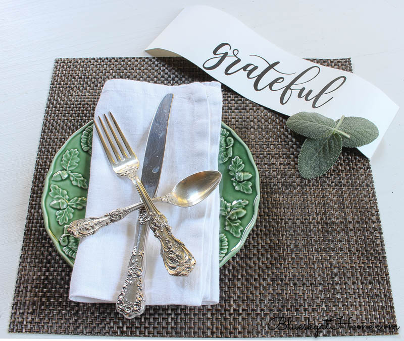 fall place setting with grateful sign and herbs