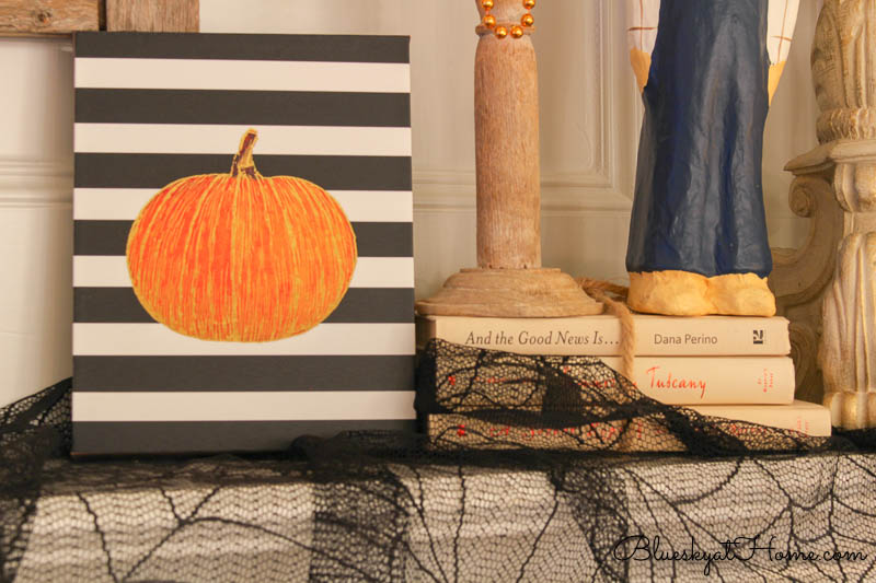 pumpkin sign with black and white stripes