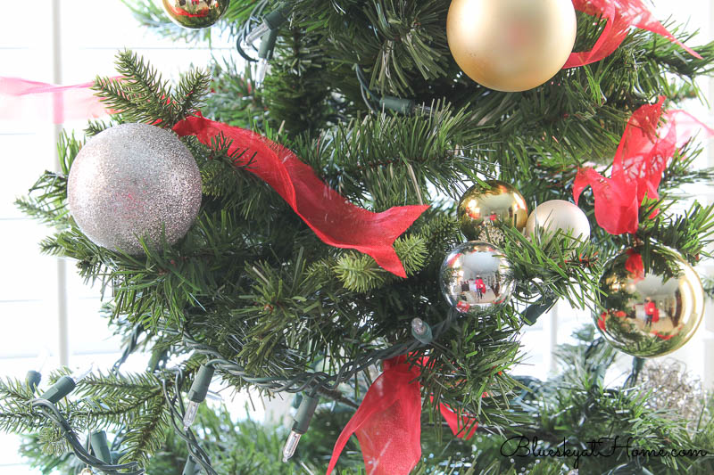 Christmas ornaments with red ribbon ties