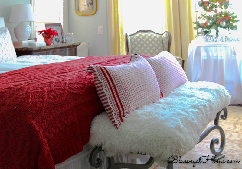 red checked Christmas pillows on bench