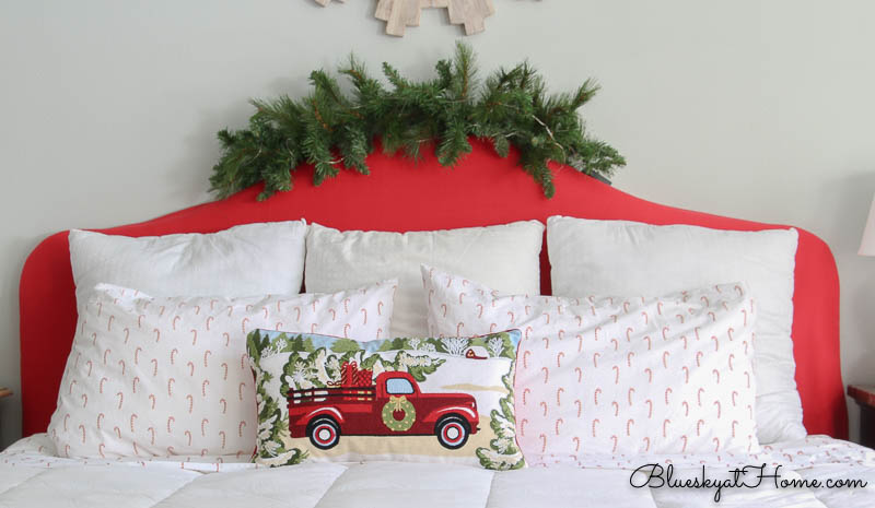 Red headboard on bed