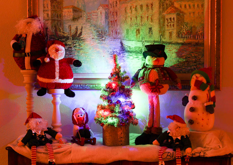 Santas and Snowmen in bedroom with Christmas Lghts