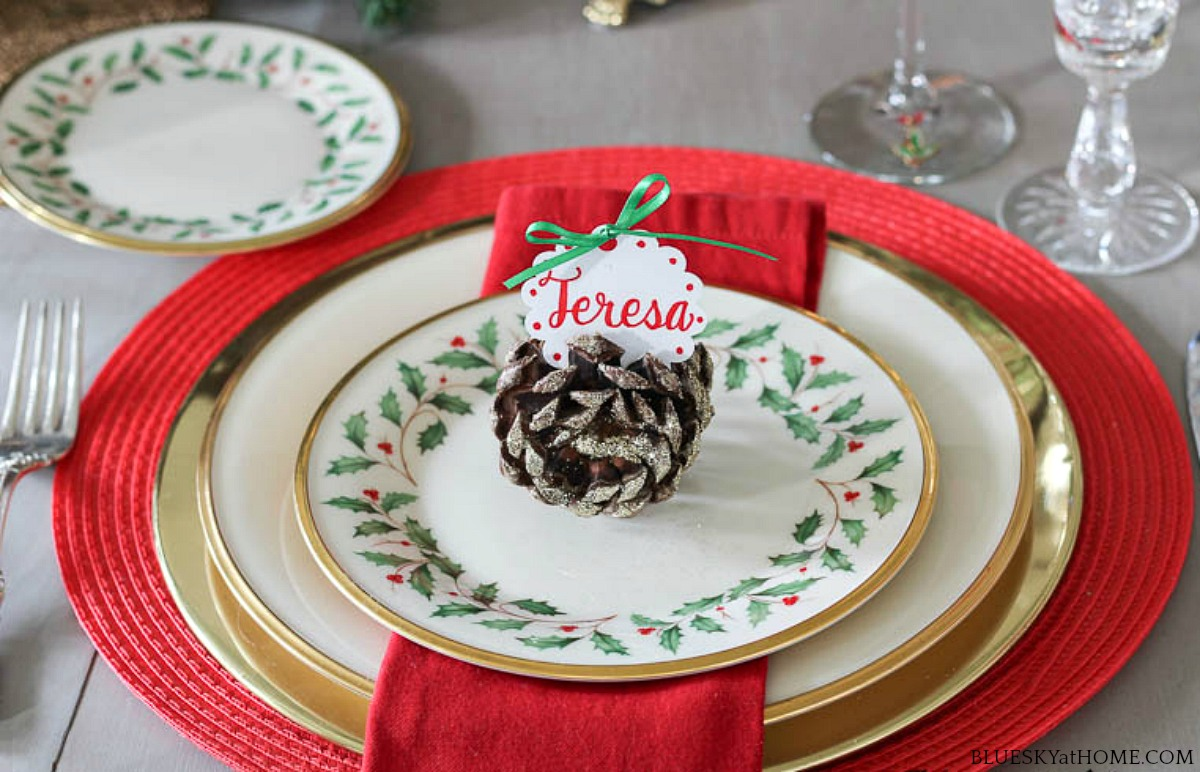 pine cone place card holder on china plate