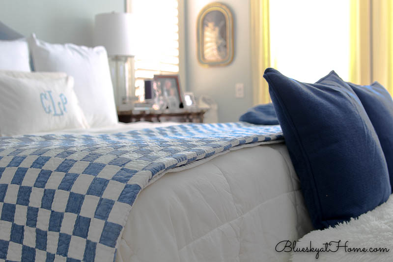 blue and white checked blanket on bed