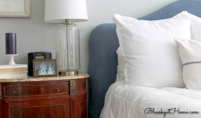 blue headboard with white pillows