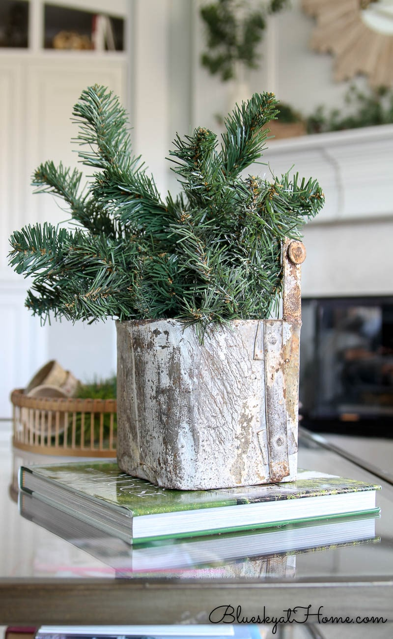 greenery in rustic container on table