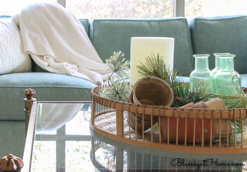 winter coffee table basket with white throw