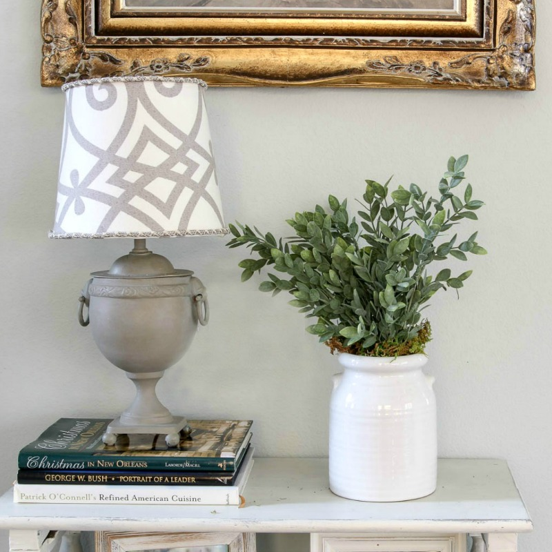 grey lamp with pattern lamp shade with faux greenery