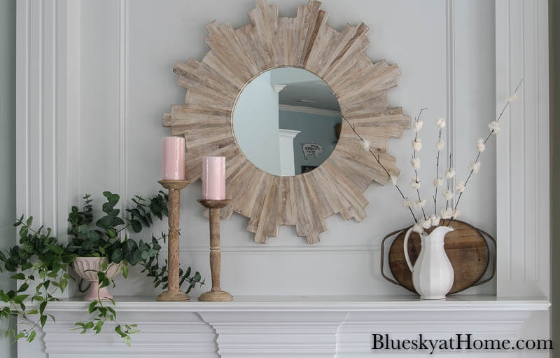 mirror, greenery, candles, white pitcher with DIY cherry blossom flowers